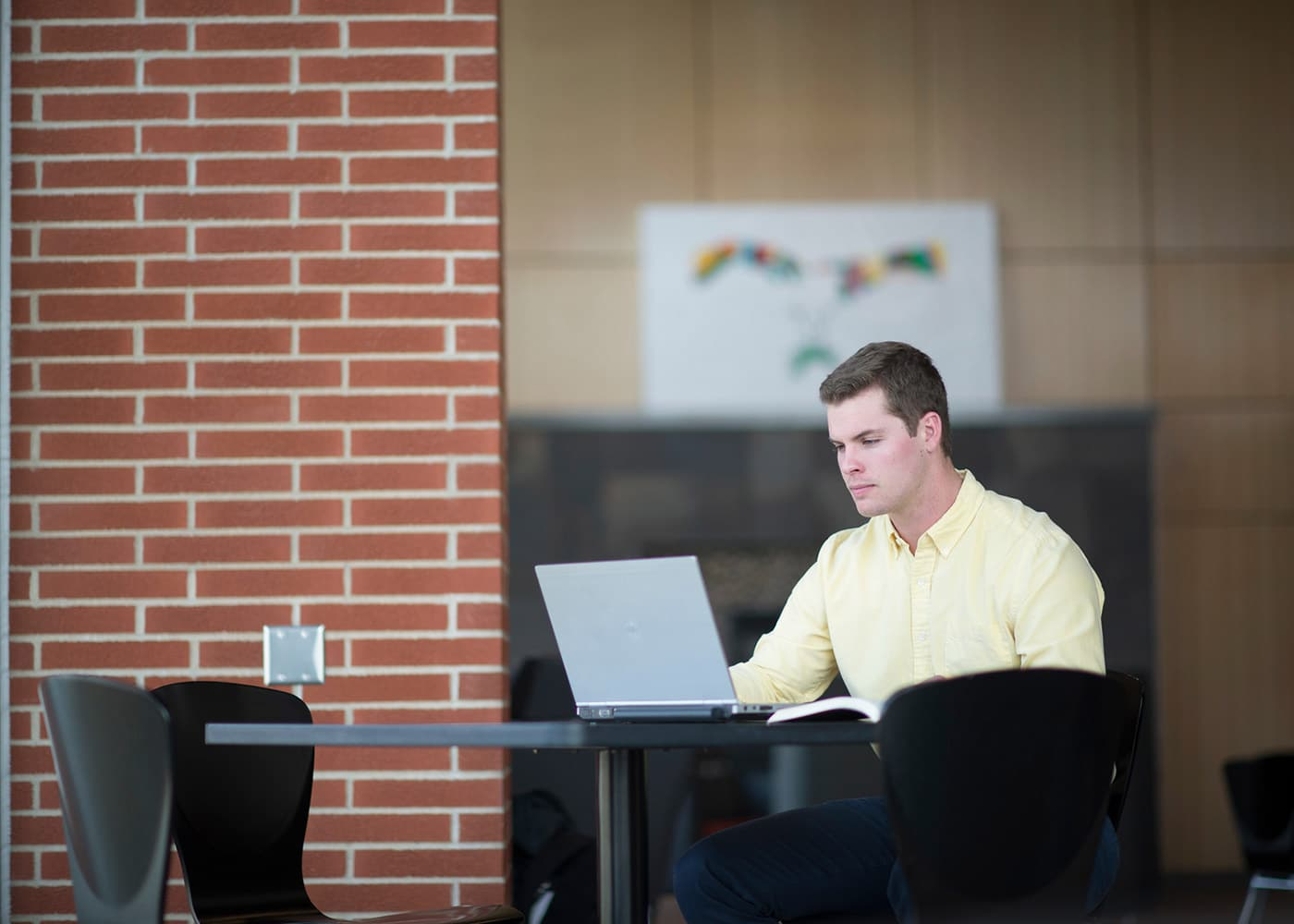 Dordt College student working on a laptop
