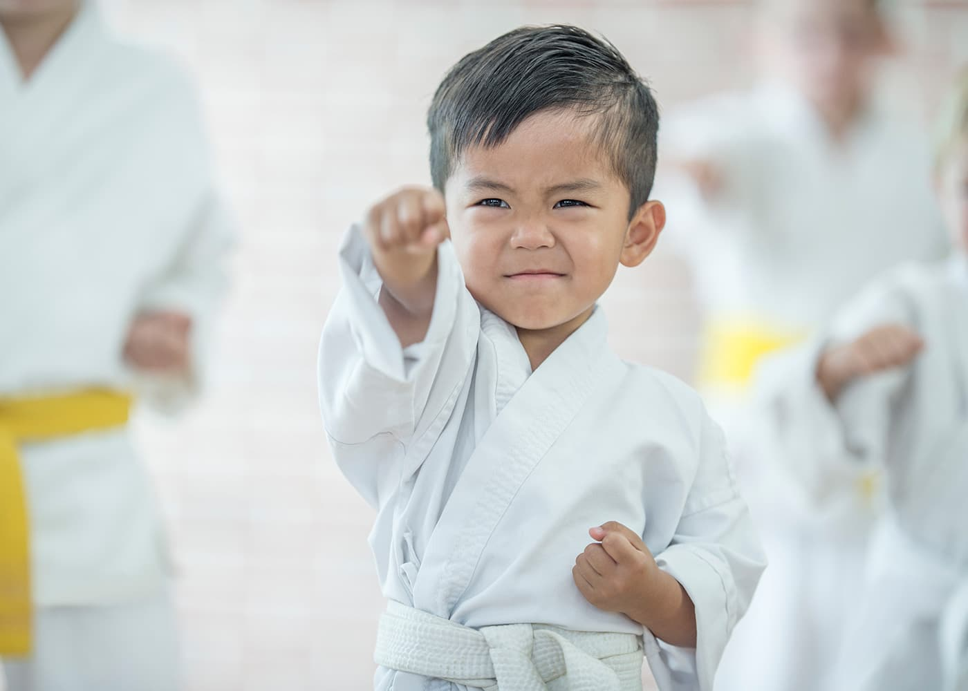 Young child practicing martial arts