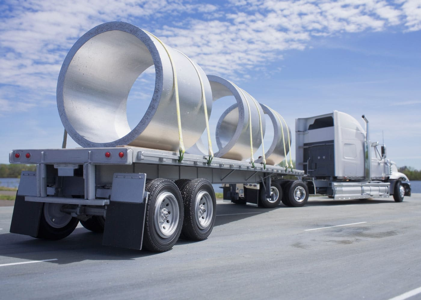 Truck transporting big steel cylinders