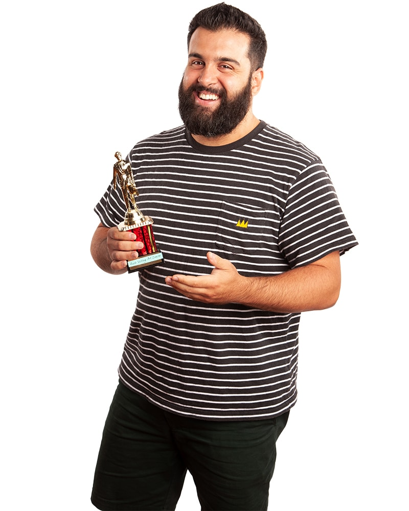 Photo of Mike Borges holding a trophy
